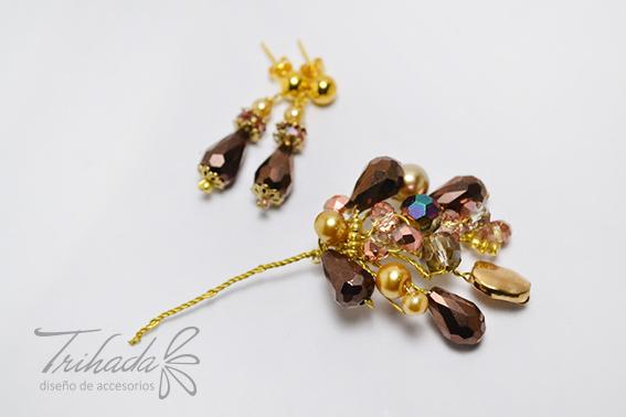 Aros y pin de cristales habano y dorado